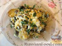Фото к рецепту: Картофель, запеченный в духовке с сыром и грибами
