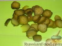 Фото приготовления рецепта: Солянка из капусты с грибами - шаг №7