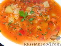 Фото приготовления рецепта: Томатный суп с рисом - шаг №12