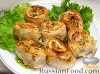 Фото к рецепту: Запеченные рулеты из семги в лаваше